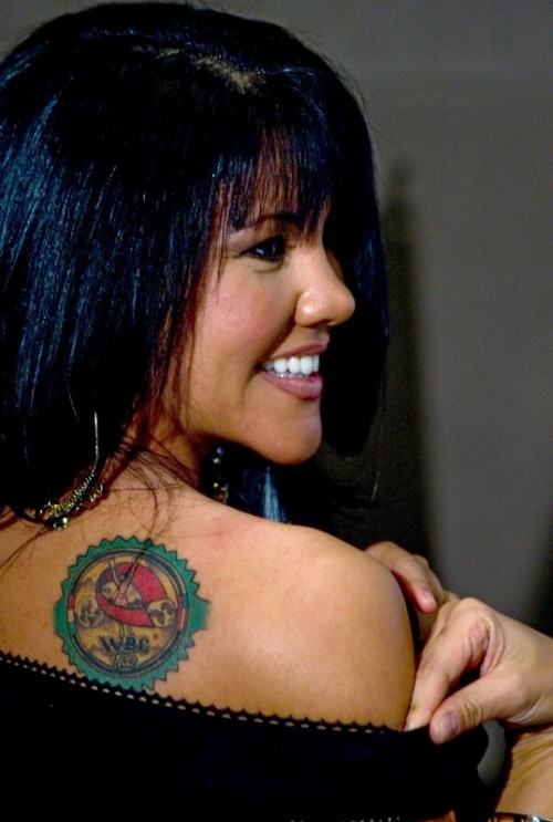 Mia St. John shows her tattoo during a press Conference in Mexico City